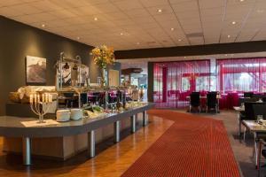 A restaurant or other place to eat at Postillion Hotel Arnhem