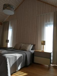 A bed or beds in a room at Marina Holiday Lotus Village