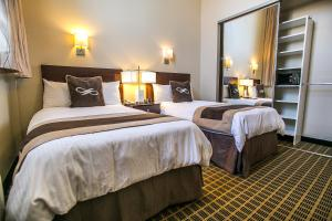 A bed or beds in a room at Pointe Plaza Hotel