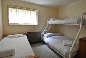 A bunk bed or bunk beds in a room at Mowamba E1
