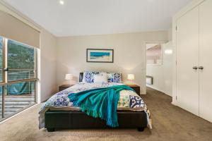 A bed or beds in a room at Bonnie Blairgowrie