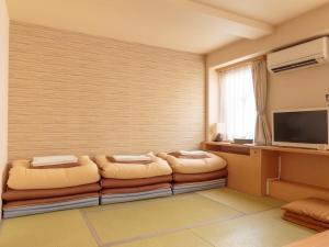 A seating area at Osaka Hana Hostel
