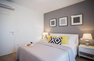 A bed or beds in a room at Villa Elysium - beautiful house with heated pool