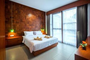 Ein Bett oder Betten in einem Zimmer der Unterkunft Pudak Sari Unizou Hostel