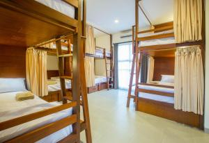 A bunk bed or bunk beds in a room at Pudak Sari Unizou Hostel