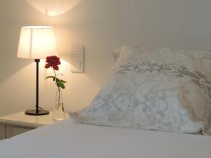 A bed or beds in a room at Le Clos du Presbytere