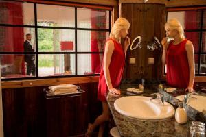 Ein Badezimmer in der Unterkunft Wellnesshotel Seeschlößchen - Privat- Spa & Naturresort