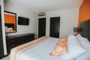 A bed or beds in a room at Talk of the Town Beach Hotel & Beach Club by GH Hoteles