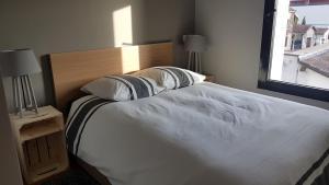 Un ou plusieurs lits dans un hébergement de l'établissement Loft Eurexpo - St Exupéry