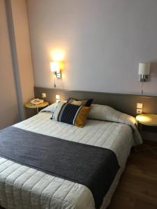 Un ou plusieurs lits dans un hébergement de l'établissement Hôtel Du Nord
