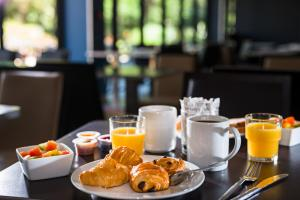 Breakfast options available to guests at Golden Tulip Marseille Airport