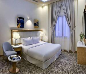 Cama ou camas em um quarto em Golden Dune Hotel & Suite