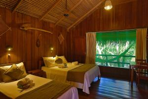 A bed or beds in a room at Juma Amazon Lodge