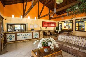 The lobby or reception area at Vila Olaria Hotel