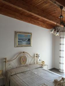 A bed or beds in a room at B&B Terre del Sinis