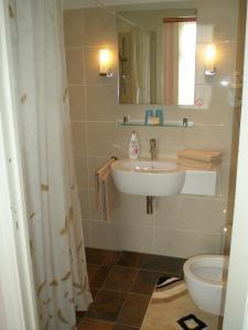 Salle de bains dans l'établissement Hotel Excelsior