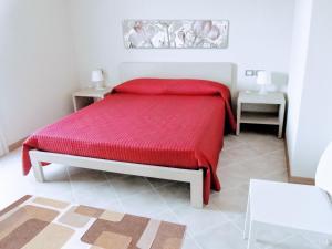 Letto o letti in una camera di Residence San Rossore