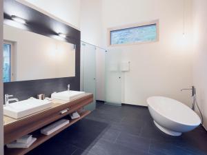 A bathroom at OVERLOOK Lodge by CERVO Zermatt