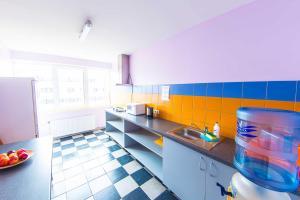 A kitchen or kitchenette at Hostel Brize