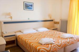 Ένα ή περισσότερα κρεβάτια σε δωμάτιο στο Hotel Nydri Beach