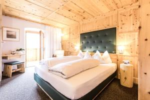 Letto o letti in una camera di Berghotel Jochgrimm - Alpine Wellness