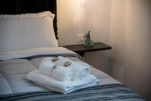 A bed or beds in a room at Villino Teresa