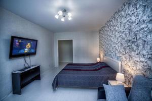 Кровать или кровати в номере Arendagrad Больничный переулок 4