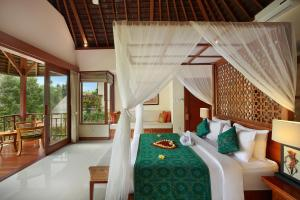A bed or beds in a room at Jannata Resort and Spa