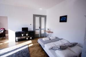 Telewizja i/lub zestaw kina domowego w obiekcie Best Location Plaza Lublin