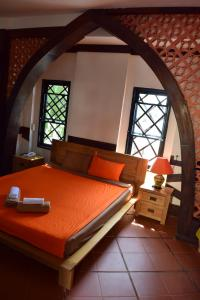 A bed or beds in a room at Hnam Chang Ngeh Hospitality training center, guest house, restaurant & bar