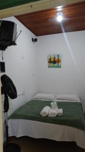 Cama ou camas em um quarto em Suítes o Flautista