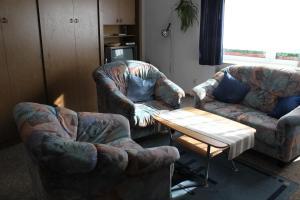 Ein Sitzbereich in der Unterkunft Ferienwohnungen Schubert