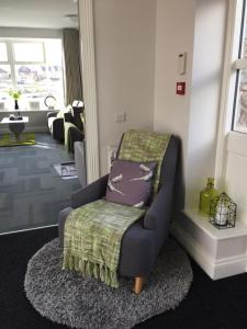 A bed or beds in a room at The Sidings Inverurie