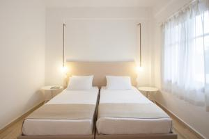 A bed or beds in a room at Paris Studios & Apartment