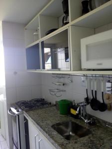 Una cocina o zona de cocina en Ajuricaba Suites 6