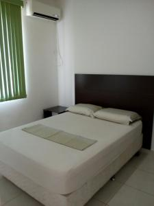 Cama o camas de una habitación en Ajuricaba Suítes 3