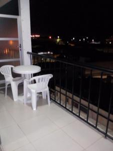 Un balcón o terraza de Ajuricaba Suítes 7