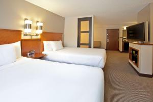 A bed or beds in a room at Hyatt Place Orlando / I-Drive / Convention Center