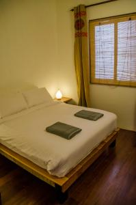A bed or beds in a room at Ren I Tang Heritage Inn