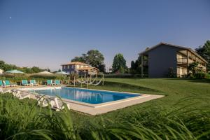The swimming pool at or near Hotel Lodge La Petite Couronne
