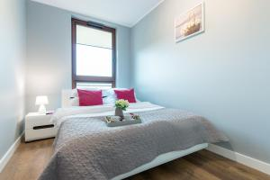 Łóżko lub łóżka w pokoju w obiekcie P&O Apartments Ordona 2