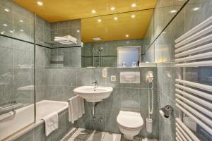 Ванная комната в Hotel Berchtold