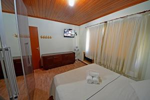 Cama ou camas em um quarto em Eco Resort Serra Imperial