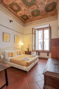 Cama o camas de una habitación en Appartamento Florence Art