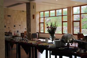 A restaurant or other place to eat at Taypikala Deluxe Valle Sagrado