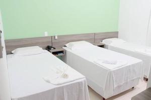 Cama ou camas em um quarto em Hotel e Locadora Vizon