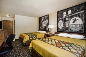 Letto o letti in una camera di Super 8 by Wyndham Flagstaff