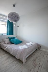 Łóżko lub łóżka w pokoju w obiekcie Apartament Świętokrzyska