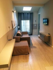 A seating area at Appartamento Battistero