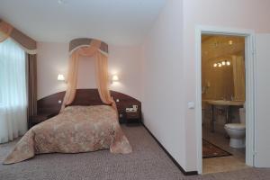 Кровать или кровати в номере Отель Русь